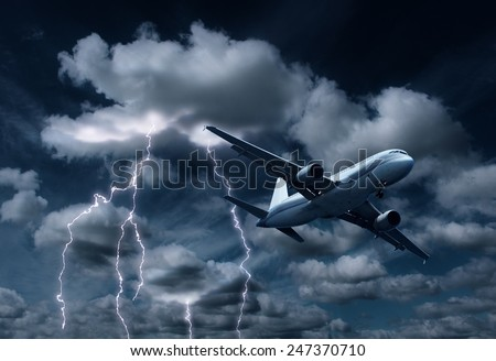Passenger aeroplane yielding turbulent thunderstorm and lightnings - stock photo
