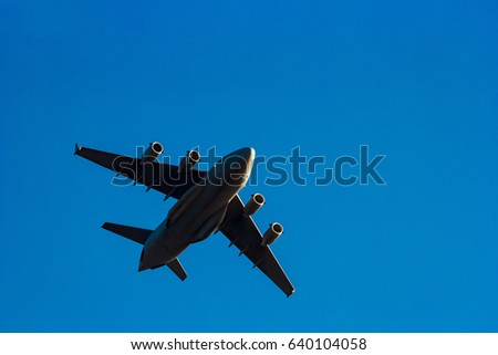 Passenger aircraft flying in the blue sky