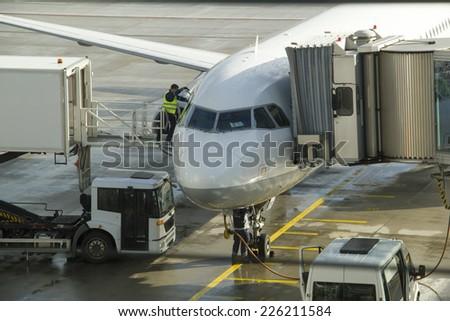 Passenger aircraft maintenance before flight at airport. - stock photo