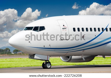 Passenger aircraft taxing to take off - stock photo