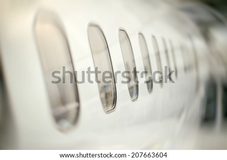 Passenger aircraft windows. View from outside. - stock photo
