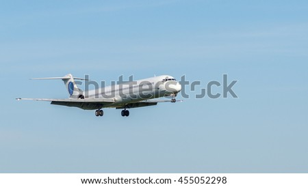 Passenger Airliner close-up view during the flight. Jet airplane, white colored fuselage, clear blue sky. Aviation copy space background.  - stock photo