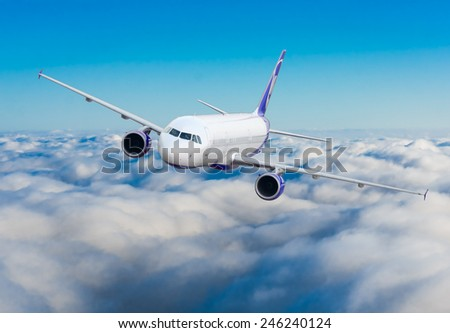 Passenger airplane flying above dramatic clouds - stock photo