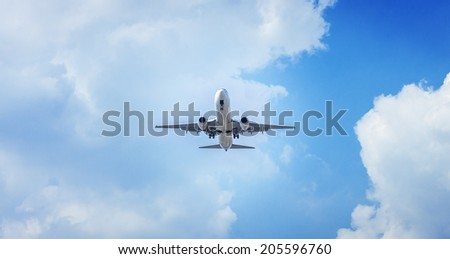 Passenger airplane flying in blue sky