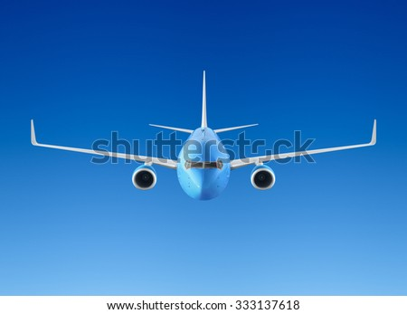 Passenger airplane flying in the blue sky - stock photo