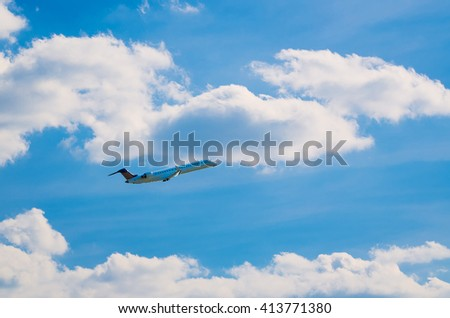 Passenger airplane flying in the blue sky with clouds, air transportation and travel background - stock photo