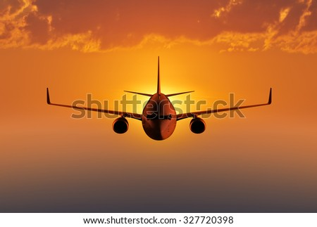 Passenger airplane flying in the evening or morning sky - stock photo
