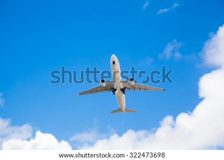 Passenger airplane in the beautiful blue clouds