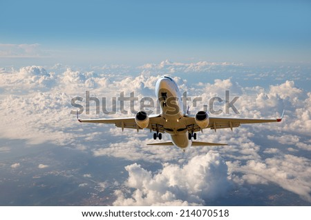 passenger airplane in the clouds. travel by air transport - stock photo