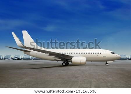 passenger airplane is landing to runway of airport - stock photo