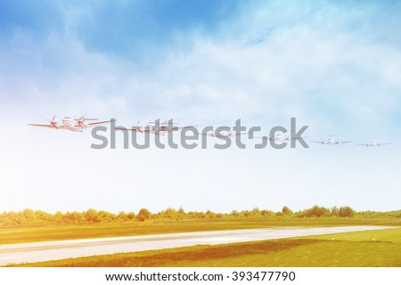 Passenger airplane landing on runway in airport. Multiple plane track - stock photo