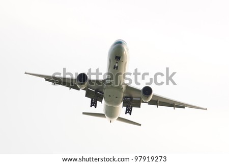 Passenger airplane view from bottom isolated over white background