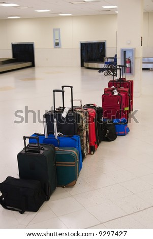 Passenger baggage and luggage in the baggage claim area of the airport - stock photo