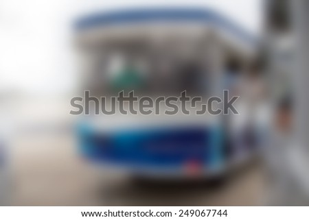 Passenger bus in motion blurred background - stock photo