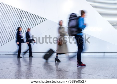 passenger in the walking at the airport - motion blur