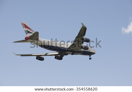 PASSENGER JET ON FINAL APPROACH TO LONDON HEATHROW AIRPORT UK  CIRCA 2015 - BA Boeing 747 jet preparing to land wheels down on final approach - stock photo