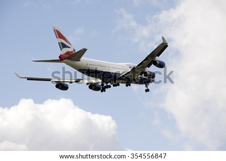 PASSENGER JET ON FINAL APPROACH TO LONDON HEATHROW AIRPORT UK - CIRCA 2015 - Boeing 747 jet preparing to land wheels down on final approach