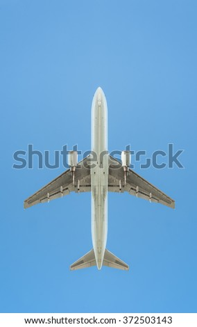 passenger jet silhouette against a clear blue sky