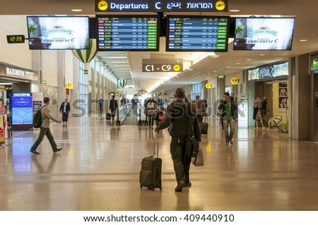 Passenger looking at the departure information board prior to his flight in the Ben Gurion International Airport stock image. Tel Aviv, Israel. December 2014.