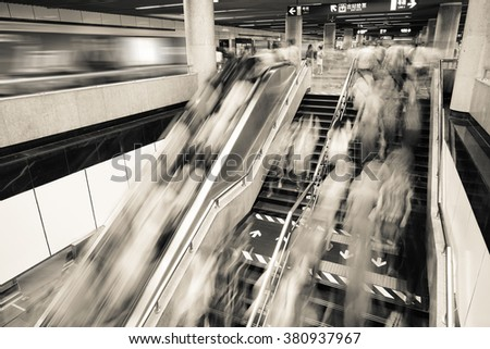 Passenger on moving escalator at subway station in Shanghai, Blur abstract.