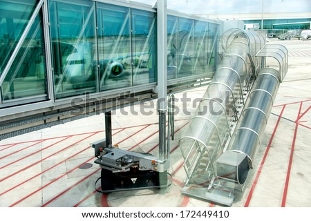 Passenger passage at airport - stock photo