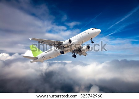Passenger plane climbs after take-off. Airplane flying high above the clouds.