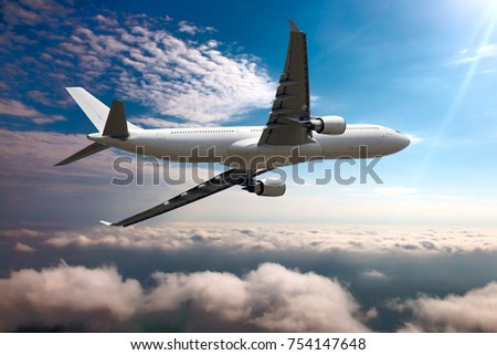 Passenger plane flies over the clouds