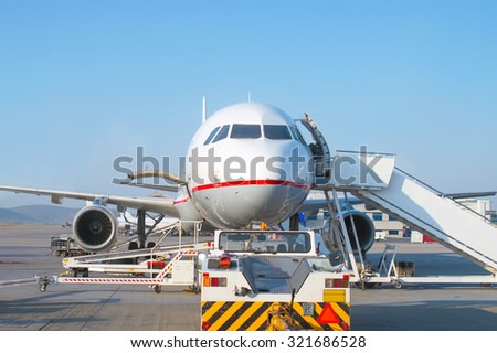 Passenger plane in the airport. Aircraft maintenance.