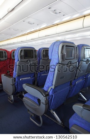 Passenger Seat of airplane, LCD monitor for copy space - stock photo