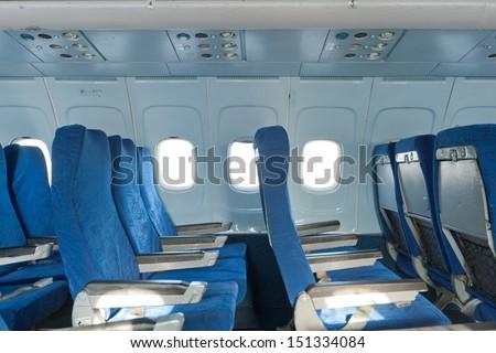 Passenger seats interior of salon of the TU 154 plane - stock photo