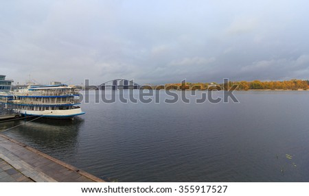 Passenger ship at the pier and a panoramic view of the Dnieper. Kiev, Ukraine