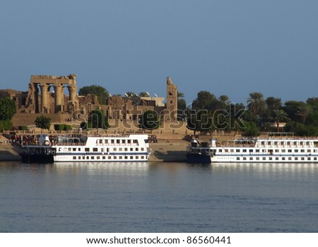 passenger ships in front of Kom Ombo in Egypt, seen from Nile - stock photo