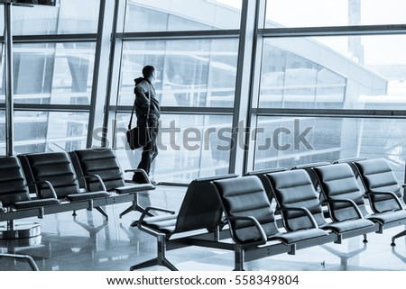 Passenger silhouette in the modern airport