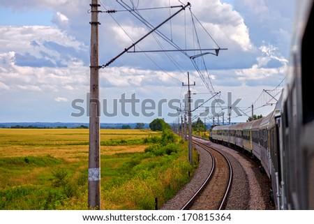 Passenger train on the railway in summer day. - stock photo