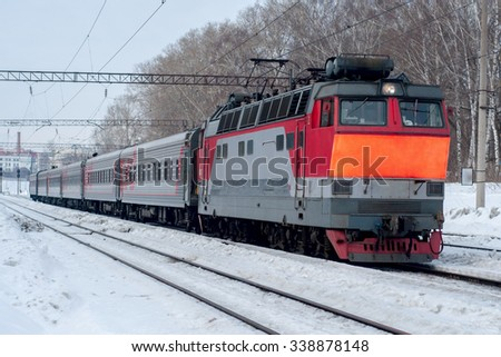passenger train traveling in the winter