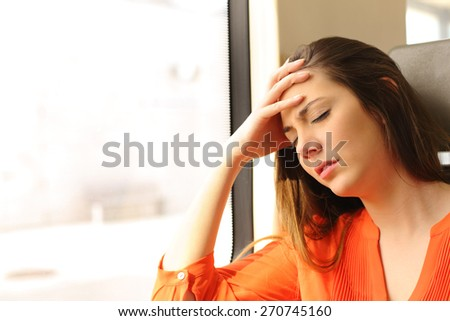 Passenger traveling and feeling dizzy with headache in a train travel - stock photo