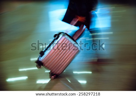 passenger walking at big city station, abstract blur. - stock photo