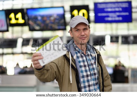 Passenger with tickets in the airport