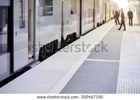 Passengers and commuter train