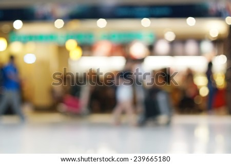 Passengers at the Airport ,Motion blur. - stock photo