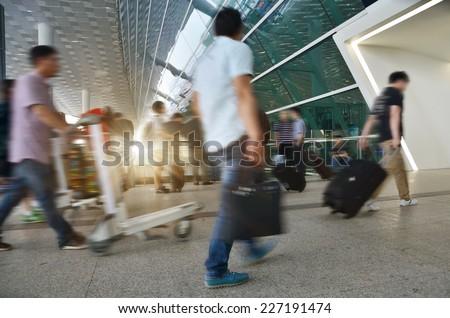 Passengers at the airport of china Shenzhen  - stock photo