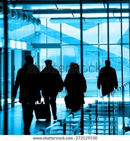 Passengers at the airport rushing to their flights - stock photo