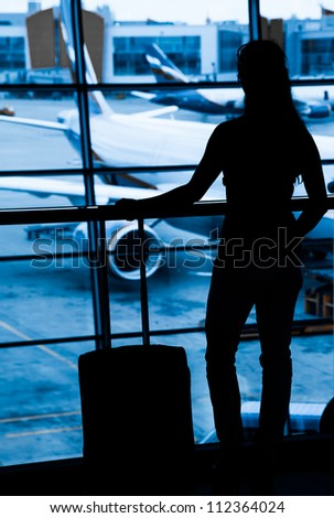 Passengers at the airport window - stock photo