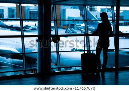 Passengers at the airport window