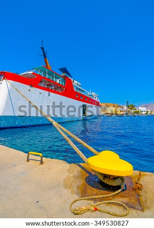 passengers ferry boat docked in the main port of Symi island in Greece