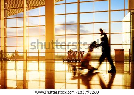 Passengers in Shanghai Pudong International Airport - stock photo