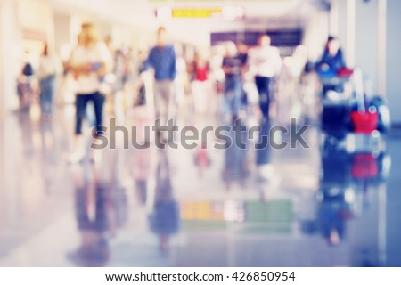 Passengers in the airport. Blurred and filtered image. - stock photo