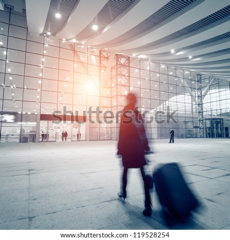 passengers motion blur in shenzhen train station waiting hall - stock photo