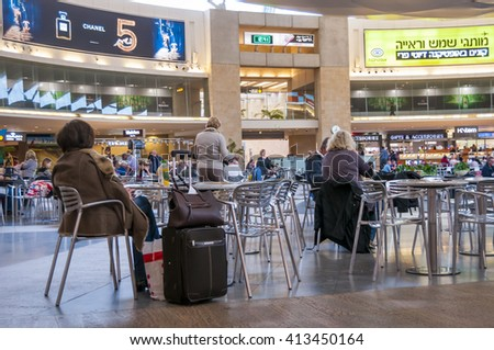 Passengers waiting for their flight in the main hall of the Ben Gurion International Airport in Tel Aviv. Israel, Middle East, November 2014. Editorial. - stock photo