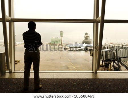 Passengers waiting to board the aircraft.